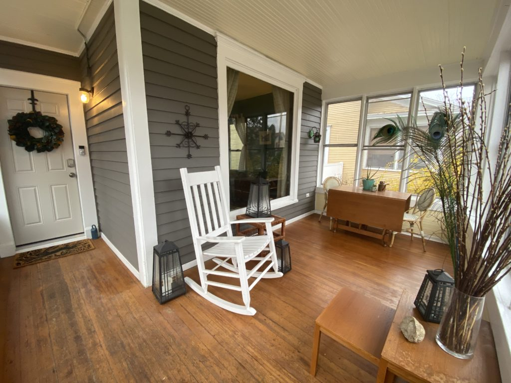 front porch with a white rocking chair